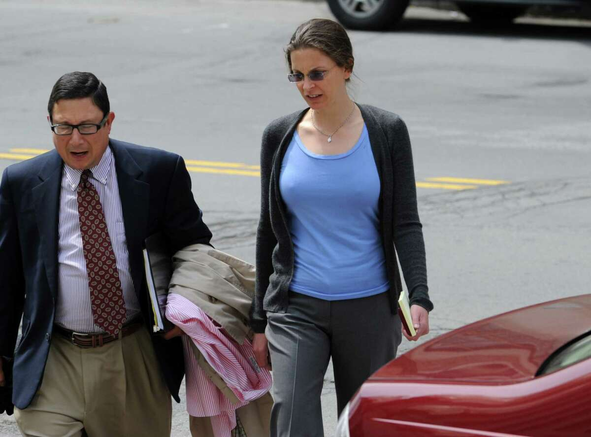 Attorney William Savino, left, and Clare Bronfman, right, walk into the Federal Courthouse on Broadway in Albany, N.Y. on Tuesday May 3, 2011. (Lori Van Buren / Times Union)