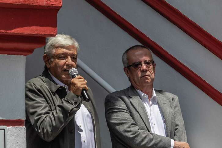 """Andres Manuel Lopez Obrador, Mexico's president-elect, left, speaks while Carlos Urzua, Mexico's finance minister nominee for president-elect Lopez Obrador, listens during a press conference in Mexico City, Mexico, on Monday, July 23, 2018. U.S. President Donald Trump on Monday said that he's in discussions with Lopez Obradorabout doing something """"very dramatic, very positive for both countries."""" Lopez Obrador told reporters he's not aware of the deal that Trump was referring to, but that he's open to talking to the administration about one. Photographer: Alejandro Cegarra/Bloomberg"""