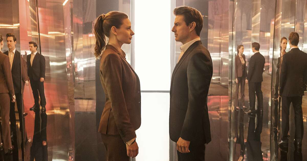 """This image released by Paramount Pictures shows Rebecca Ferguson, left, and Tom Cruise in a scene from """"Mission: Impossible - Fallout."""" (Chiabella James/Paramount Pictures and Skydance via AP)"""
