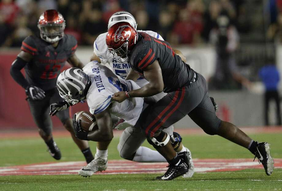 Memphis Tigers running back Patrick Taylor Jr. #6 is tackled by Houston Cougars defensive tackle Ed Oliver #10 on Thursday, October 19, 2017. Photo: Tim Warner, Freelance / For The Chronicle / Houston Chronicle