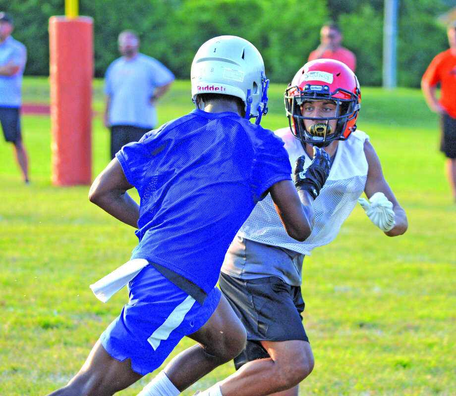 Edwardsville junior Ethan Young, right, covers an Alton Marquette receiver during Monday's 7-on-7 scrimmage at EHS. Photo: Scott Marion
