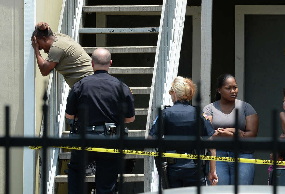 A woman cries out at Beaumont's Autumn Oaks Apartments after a shooting that killed one man on Tuesday. Police are looking for an older model Chevy Tahoe in connection with the shooting. The homicide is the ninth in the city this year. Photo taken Tuesday, 7/24/18 Photo: Guiseppe Barranco/The Enterprise / Guiseppe Barranco ?