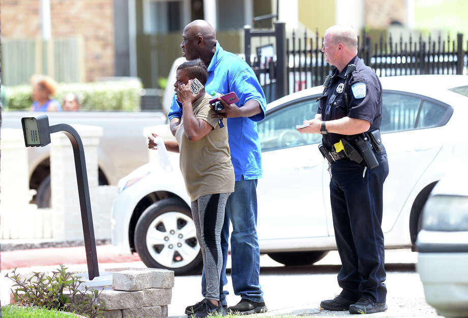A man embraces a distraught woman at Beaumont's Autumn Oaks Apartments after a shooting that killed one man on Tuesday. Police are looking for an older model Chevy Tahoe in connection with the shooting. The homicide is the ninth in the city this year. Photo taken Tuesday, 7/24/18 Photo: Guiseppe Barranco/The Enterprise / Guiseppe Barranco ?