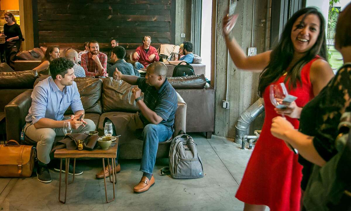 People have drinks in the bar at Dirty Water in San Francisco, Calif., on August 20th, 2015.