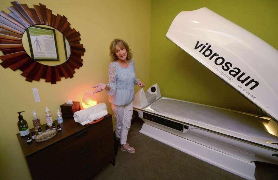 Owner of Kure Spa & Wellness Center, Liz Lew, aims to help patients relieve stress and detox from medication using Vibrosaun vibration therapy at their location in Norwalk, Conn. Lew used the technology herself for her insomnia and later founded the spa featuring vibration and other alternative therapies. Photo: Erik Trautmann / Hearst Connecticut Media / Norwalk Hour