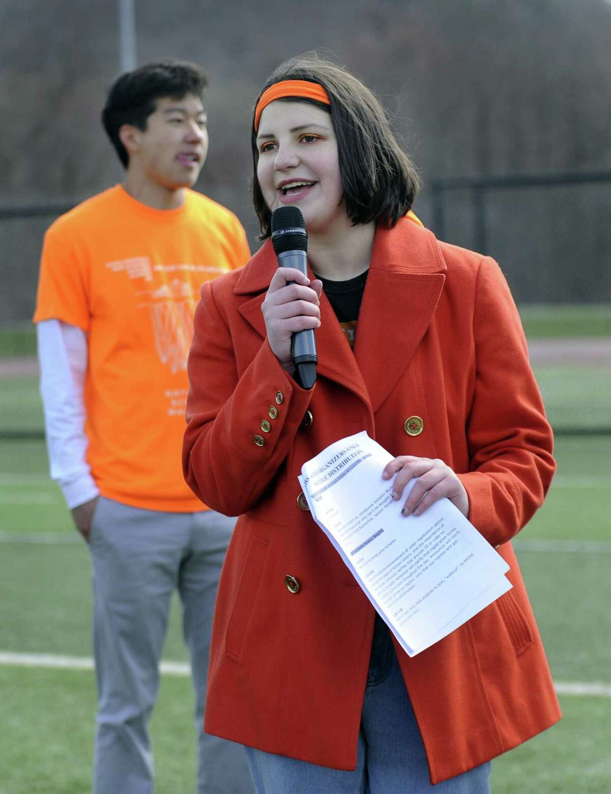 Lane Murdock, 16, a Ridgefield High School student and the founder of The National School Walkout, speaks at the Riddgefiel High School event, Friday, April 20, 2018. Left is Paul Kim, 17, also an organizor.