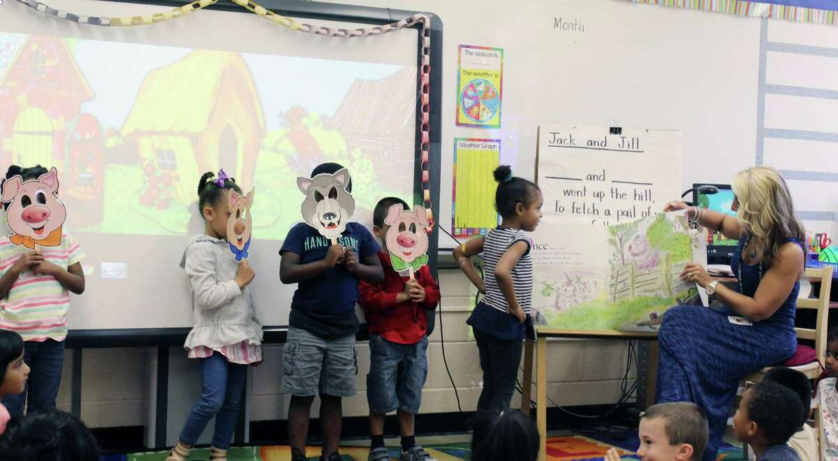 """Students at the Summer Start program at Stillmeadow Elementary School in Stamford, Conn. act out a reading of """"The Three Little Pigs."""" Summer Start offers 76 incoming kindergartners in Stamford a chance at a preschool experience before starting school in the fall."""