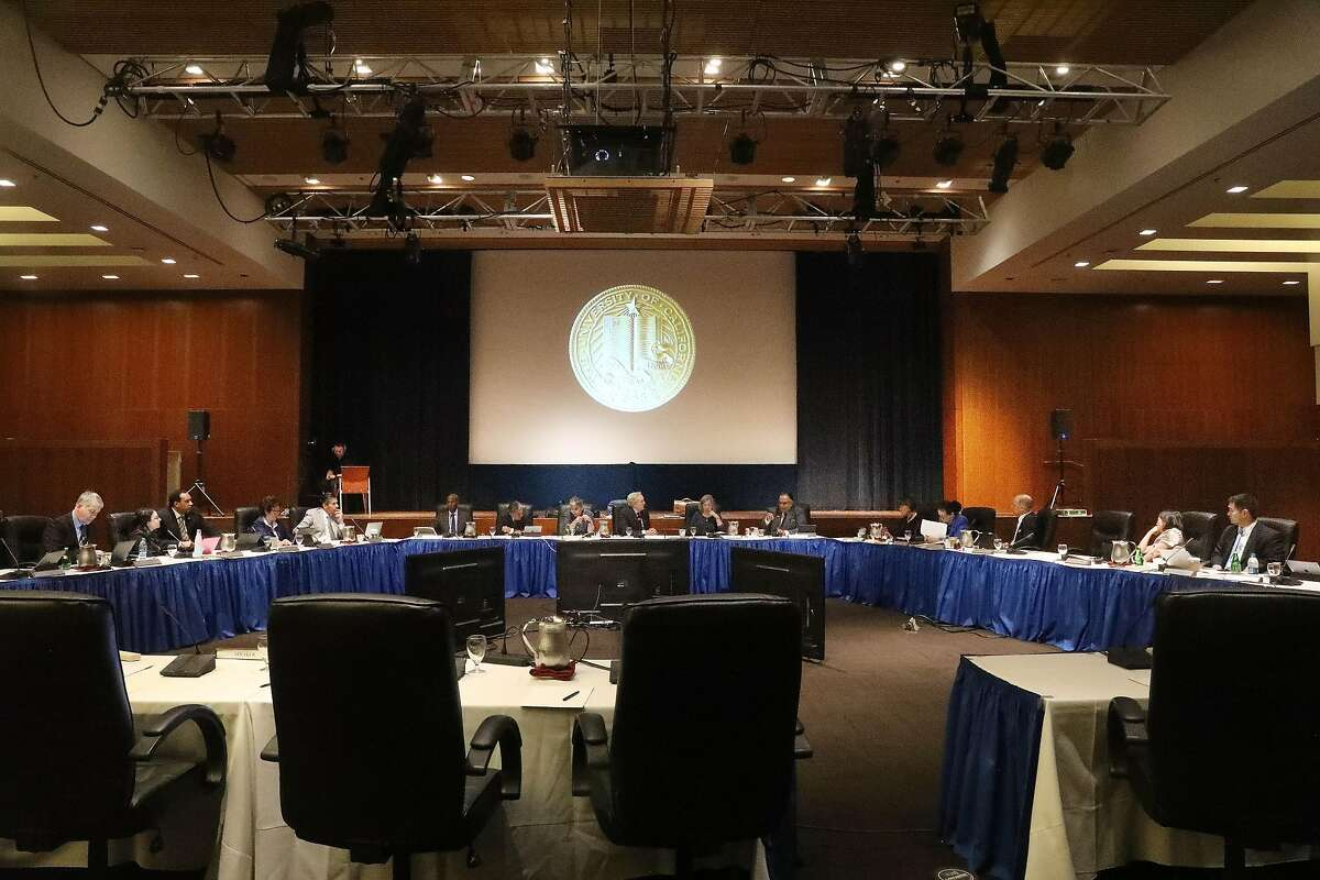 The UC Board of Regents and officers sit around the dais as they meet at the UCSF Mission Bay campus on Thursday, July 19, 2018 in San Francisco, Calif.