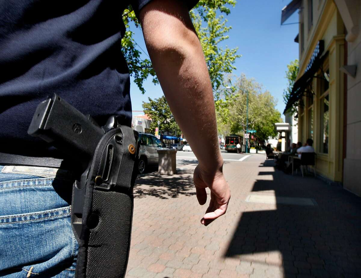 """Brad Huffman wears his .45 caliber handgun while walking on North Main Street in downtown Walnut Creek, Calif., on Wednesday, April 7, 2010. Huffman is among a growing number of gun owners that are advocating the """"Open Carry"""" law which allows law abiding citizens to carry holstered unloaded handguns."""