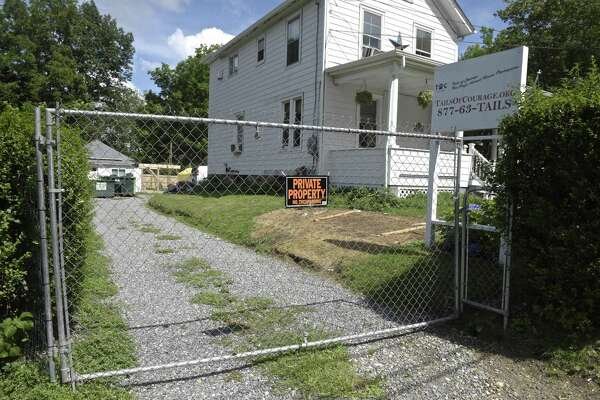 A new city lawsuit accuses nonprofit animal shelter Tails of Courage, at 39 Smith Street, with defying a cease and desist order and continuing to shelter and offer for adoption animals on the property. Tuesday, July 24, 2018, in Danbury, Conn.