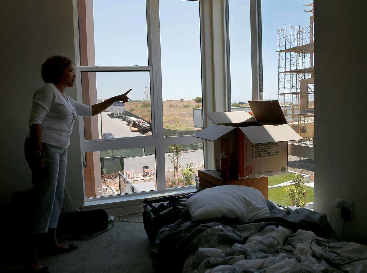 Linda Parker Pennington looks out the window of her new three bedroom home Monday June 8, 2015. 88 new housing units are being built and some have moved in to the former Hunters Point Naval Shipyard in San Francisco, Calif. This cleaned up Superfund site is now welcoming the new homeowners.