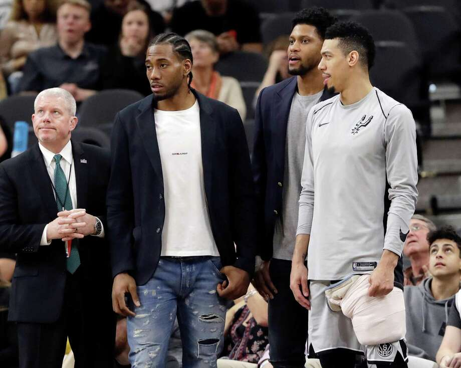 FILE - In this Jan. 21, 2018, file photo, San Antonio Spurs guard Danny Green, right, stands at the bench with injured teammates Kawhi Leonard, second from left, and Rudy Gay, center, during the second half of an NBA basketball game against the Indiana Pacers in San Antonio. General manager R.C. Buford acknowledges star forward Kawhi Leonard is unhappy with the Spurs. He remains optimistic the relationship can be salvaged. (AP Photo/Eric Gay, File) Photo: Eric Gay, STF / Associated Press / Copyright 2018 The Associated Press. All rights reserved.