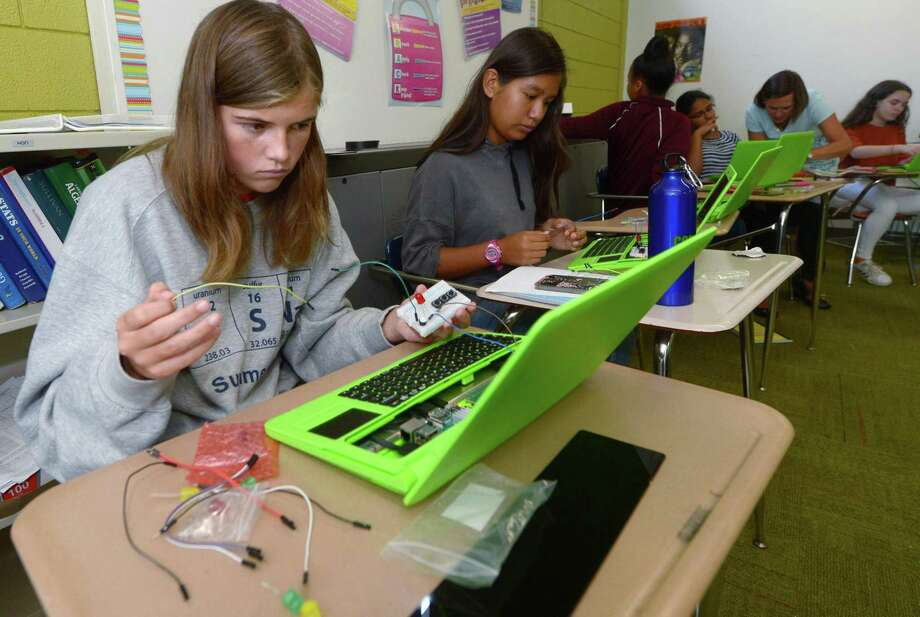 Students including Kelsey McClung, 14, build their own laptops during the two-week Amazing Girls Science boot camp on Tuesday at Norwalk High School. Photo: Erik Trautmann / Hearst Connecticut Media / Norwalk Hour