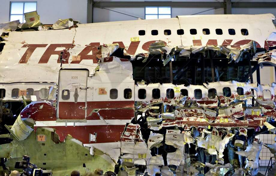 This July 16, 2008, file photo shows the recovered wreckage of TWA Flight 800 standing reassembled at the National Transportation Safety Board Training Academy in Chantilly, Va., where it is used for training new investigators. TWA Flight 800 exploded over the Atlantic Ocean off the Long Island borough of New York in 1996, killing all 230 people aboard. Photo: J. Scott Applewhite / Associated Press / AP
