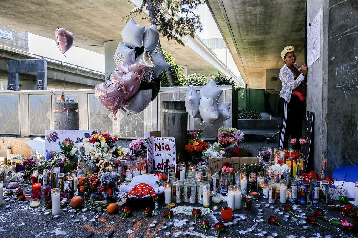 Malina King writes a note on the wall at a memorial at MacArthurt BART Station for Nia Wilson on Tuesday, July 24, 2018, in Oakland. Calif.