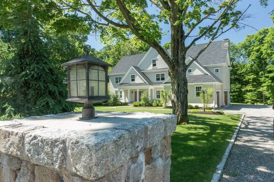 The custom colonial house at 71 Hurlbutt Street in South Wilton is conveniently located with access to three town centers. Photo: SUE FERGUSON