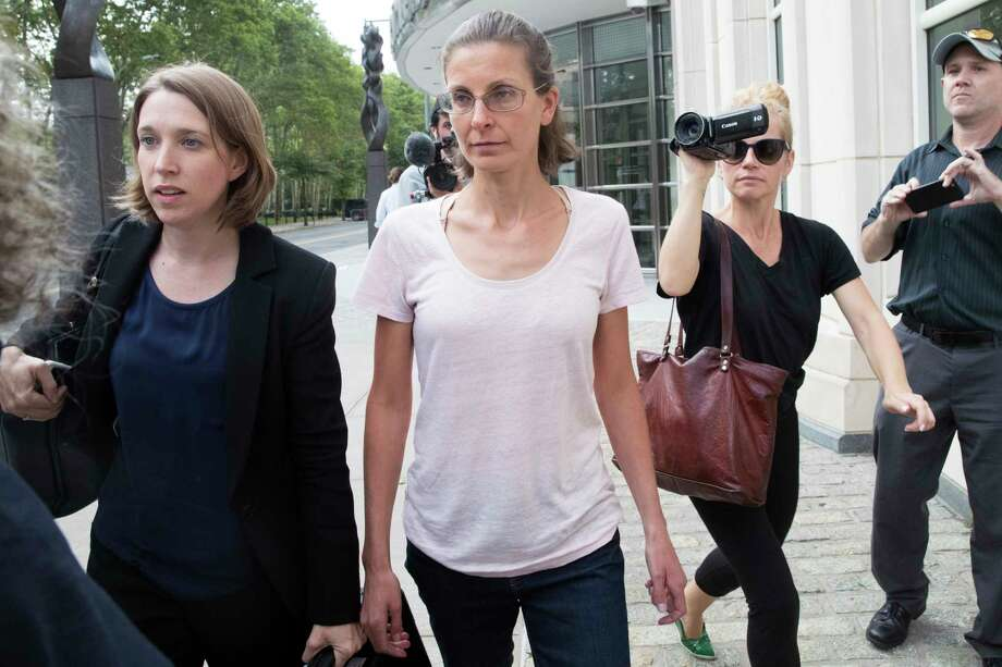 Clare Bronfman, center, leaves federal court, Tuesday, July 24, 2018, in the Brooklyn borough of New York. Bronfman, an heiress to the Seagram's liquor fortune and three other people were arrested on Tuesday in connection with the investigation of a self-improvement organization accused of branding some of its female followers and forcing them into unwanted sex. Photo: Mary Altaffer, AP / Copyright 2018 The Associated Press. All rights reserved.