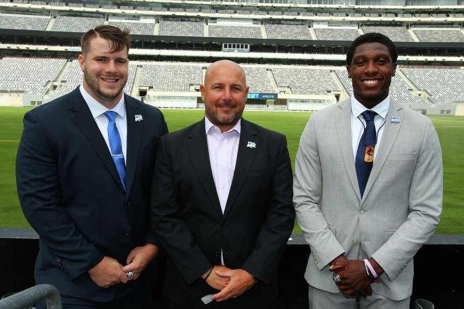 Central Connecticut defensive lineman Chris Tinkham, coach Pete Rossomando and wide receiver Courtney Rush pose for a photo during NEC media day at MetLife Stadium in East Rutherford, N.J. on Tuesday. Photo: Contributed Photo / Stamford Advocate Contributed