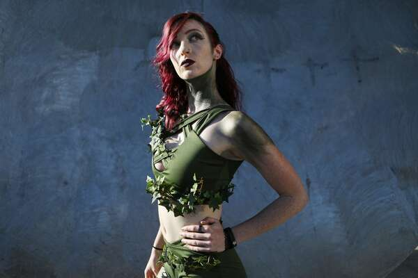 SAN DIEGO, CA - JULY 19: A cosplayer dressed as Poison Ivy poses outside San Diego Comic-Con on July 19, 2018 in San Diego, California. Thousands of revelers are arriving for the festivities at the annual comic and entertainment convention. (Photo by Mario Tama/Getty Images)