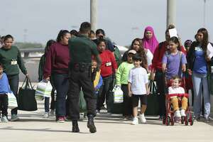 Immigrant families arrive at the San Antonio International Airport from from a family residential center in Dilley, Texas, Tuesday, July 10, 2018.