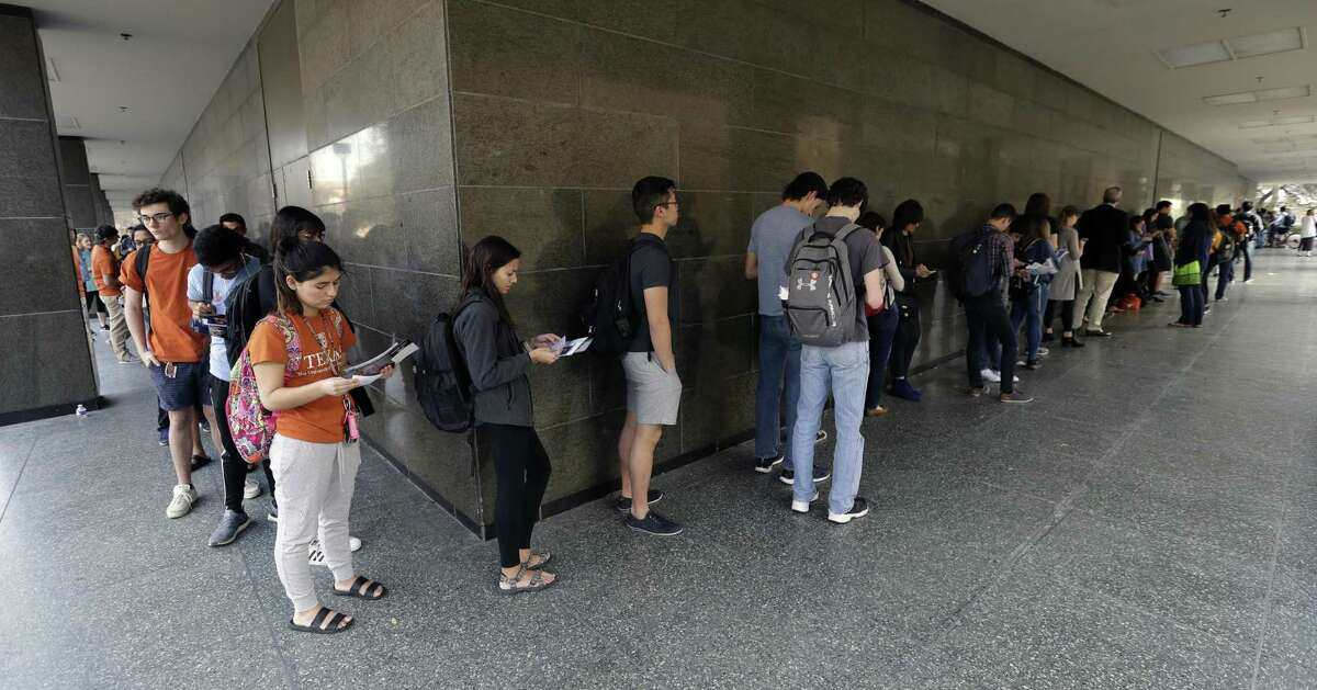 FILE - In this March 6, 2018, file photo, a line of mostly students wait to vote at a Texas primary election polling site on the University of Texas campus in Austin, Texas. Texas holds its primary runoff election Tuesday, May 22, 2018, just four days after a trench coat-clad student killed at least 10 people and wounded others at his Santa Fe High School near Houston. But it's unlikely to be a major factor in Tuesday's balloting, which will decide 34 races, including for governor and Congress, where no candidate won at least 50 percent of the votes cast during Texas' March 6 primary. (AP Photo/Eric Gay, File)