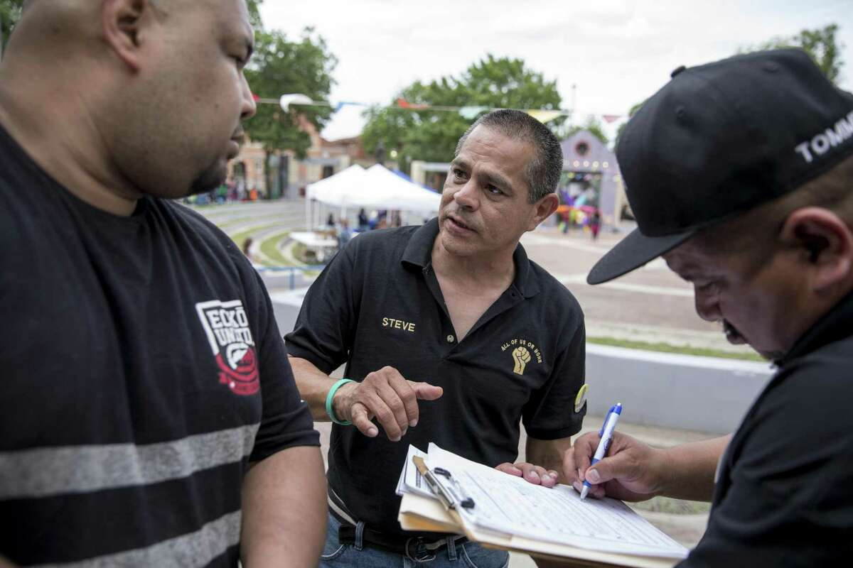 Steve Huerta, a community organizer for All of Us or None, works to register people to vote and sign up to receive information from the organization, at the Fiesta de los Ninos event in San Antonio, April 29, 2018. Huerta has started a campaign to encourage former felons to vote, which is their right in Texas as long as they are no longer on probation or parole. (Ilana Panich-Linsman/The New York Times)