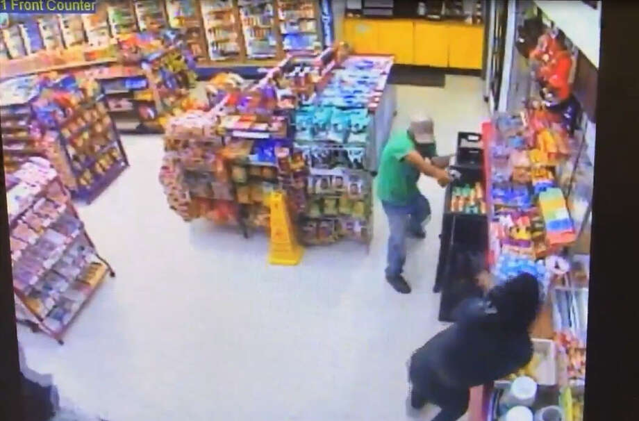 Stills from surveillance footage released by Houston police shows two suspects wanted in connection with a recent fatal shooting at a Houston convenience store. (Houston Police Department) Photo: Houston Police Department