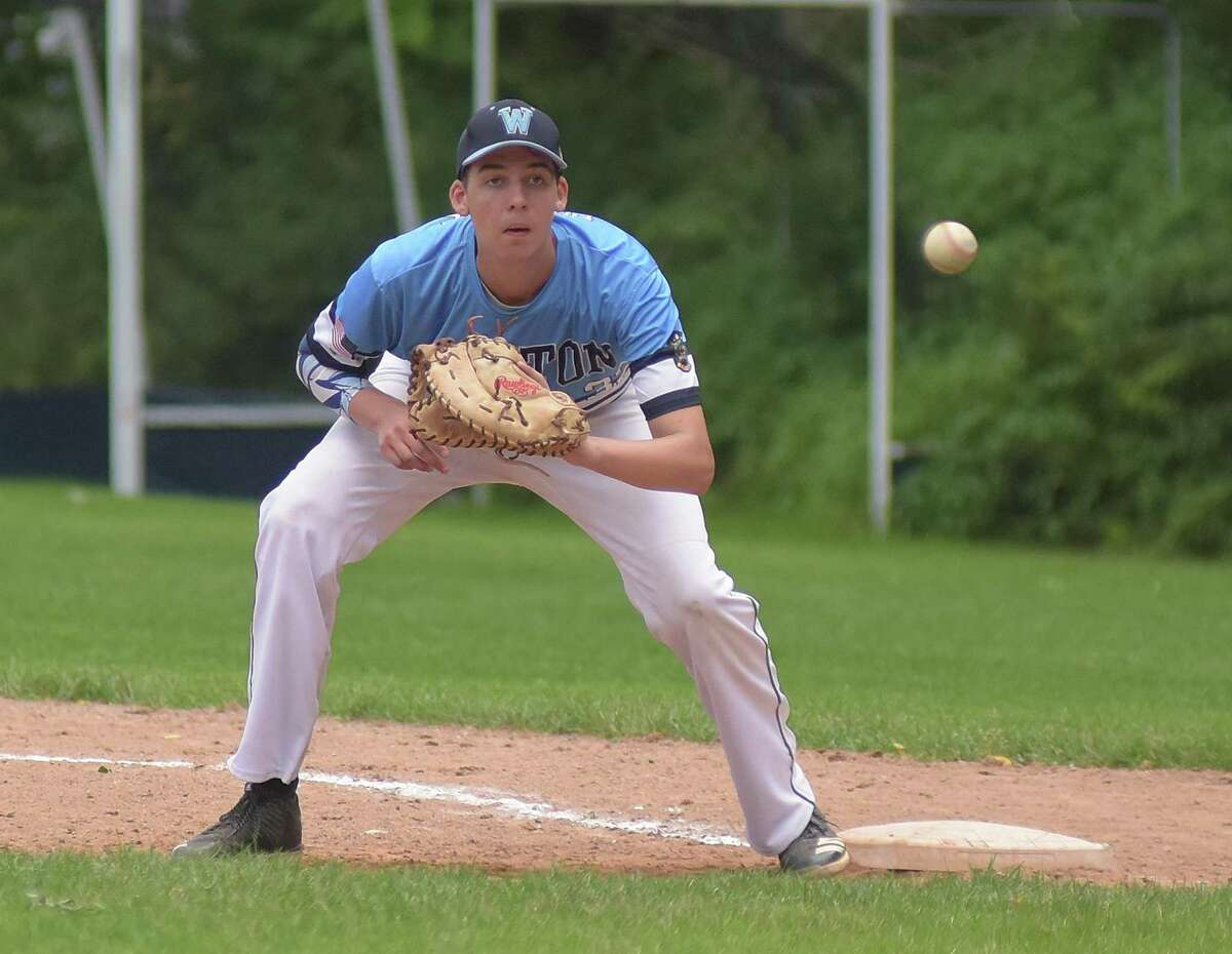 Wilton Post 86 first baseman Ben Olson keeps his eye on an approaching ball during Tuesday's American Legion state tournament game at Wilton High School.