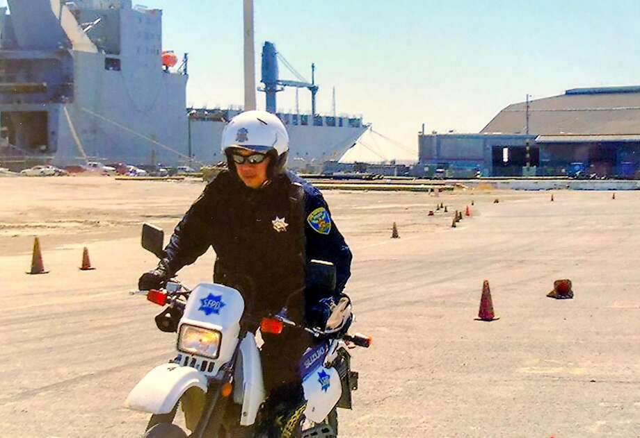 San Francisco Police Officer Lewis Fong, who is now retired, during an August 2007 motorcycle training near Building 606 at the former Hunters Point Naval Shipyard. Photo: Kelvin Lai / Courtesy Lewis Fong