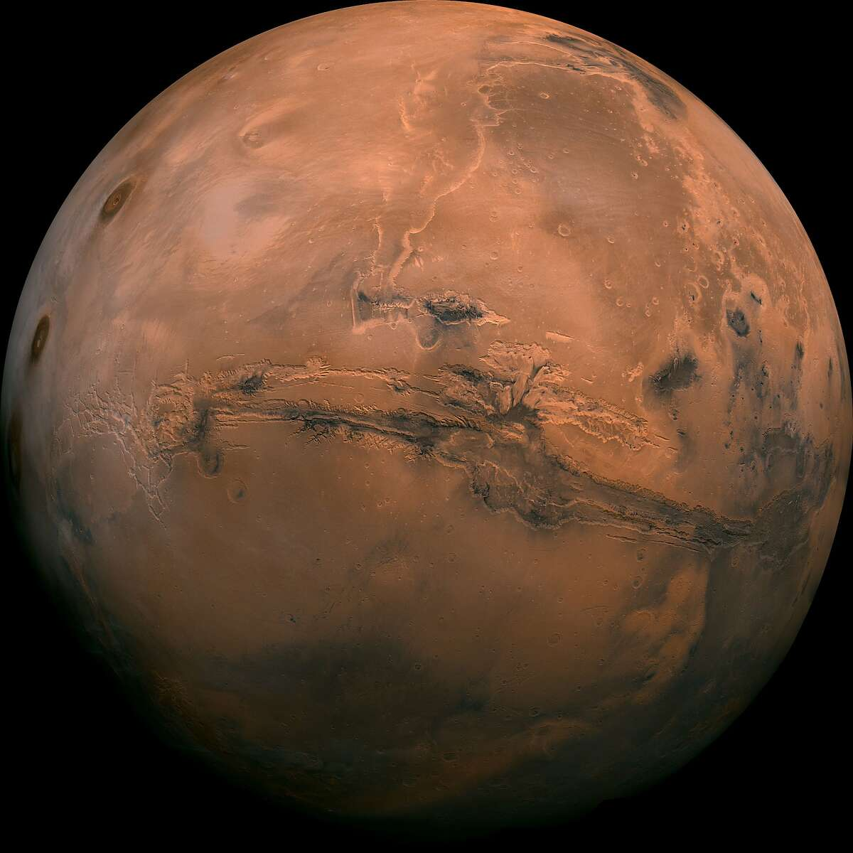 FILE - This image made available by NASA shows the planet Mars. This composite photo was created from over 100 images of Mars taken by Viking Orbiters in the 1970s. On Tuesday, July 31, 2018, the red planet will make its closest approach to Earth in 15 years.
