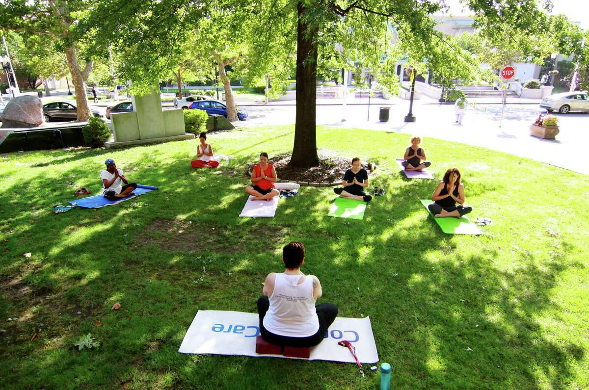 Yoga In Our City, presented by ConnectiCare, brings free yoga classes to McLevy Green in Bridgeport, Conn., on Tuesday, July 24, 2018. ConnectiCare has teamed up with local yoga studio, Great Heart Yoga, to offer the free classes at McLevy Green and Seaside Park throughout the summer months. Classes are held each Tuesday at 5:00 PM at McLevy Green and again on Saturday at 9:30 AM at Seaside Park.