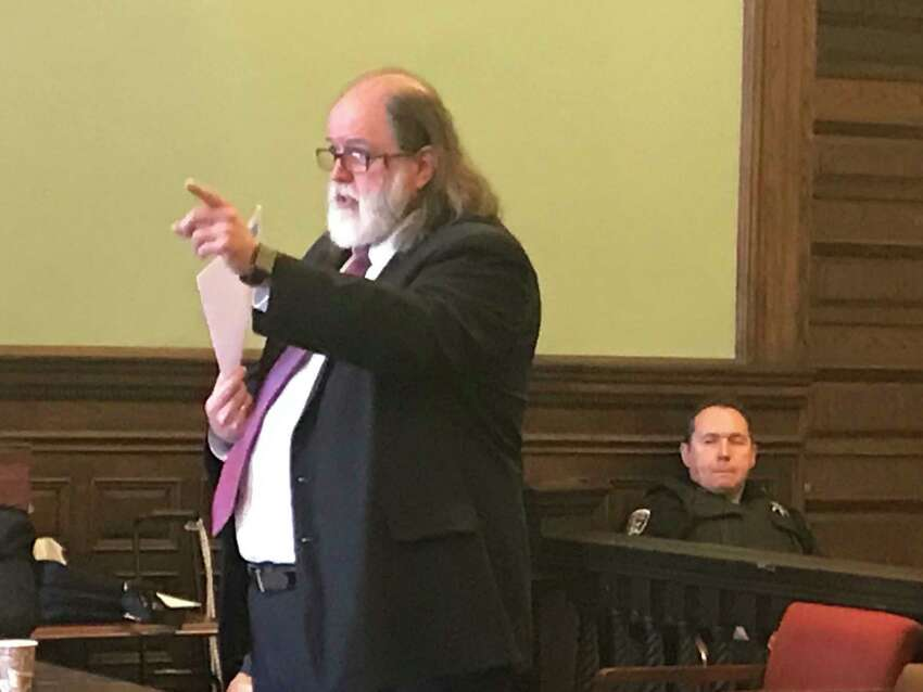 Defense attorney Michael P. McDermott gestures during his closing statement in the Rensselaer County Court House retrial of defendant RIchard J. Wright on murder and arson charges in Troy on July 20, 2018