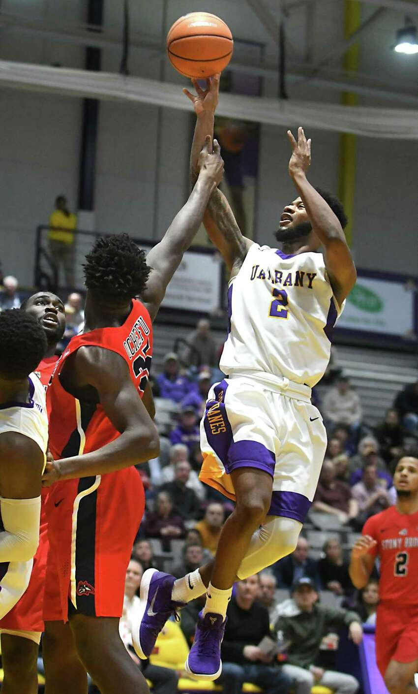 University at Albany's Ahmad Clark takes a shot guarded by Stony Brook's Anthony Ochefu during a basketball game at SEFCU Arena on Wednesday, Jan. 10, 2018 in Albany, N.Y. (Lori Van Buren/Times Union)