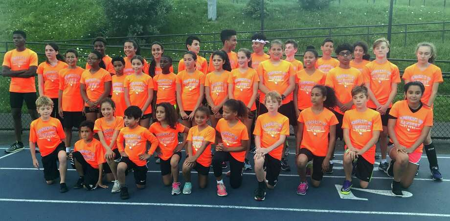 The Danbury Flyers youth track team will send a host of athletes to national meets in the coming week. Photo: Ryan Lacey /Hearst Connecticut Media
