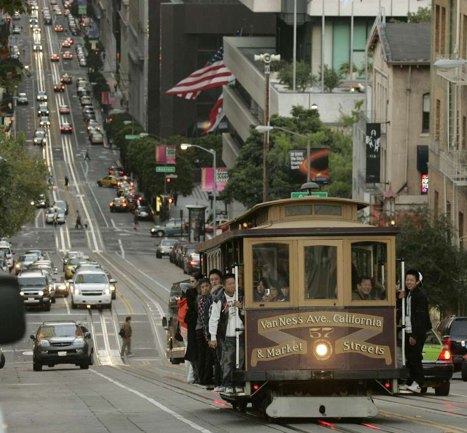 File: A cable car makes its way up a steep hill on California St. in San Francisco, Wednesday, Oct. 8, 2008. Muni temporarily halted its California Cable Car Line service on Thursday, Feb. 7, 2019, after commuters sought an alternative route on the Bay Bridge after chunks of concrete fell from the Richmond-San Rafael Bridge. Photo: Marcio Jose Sanchez / AP