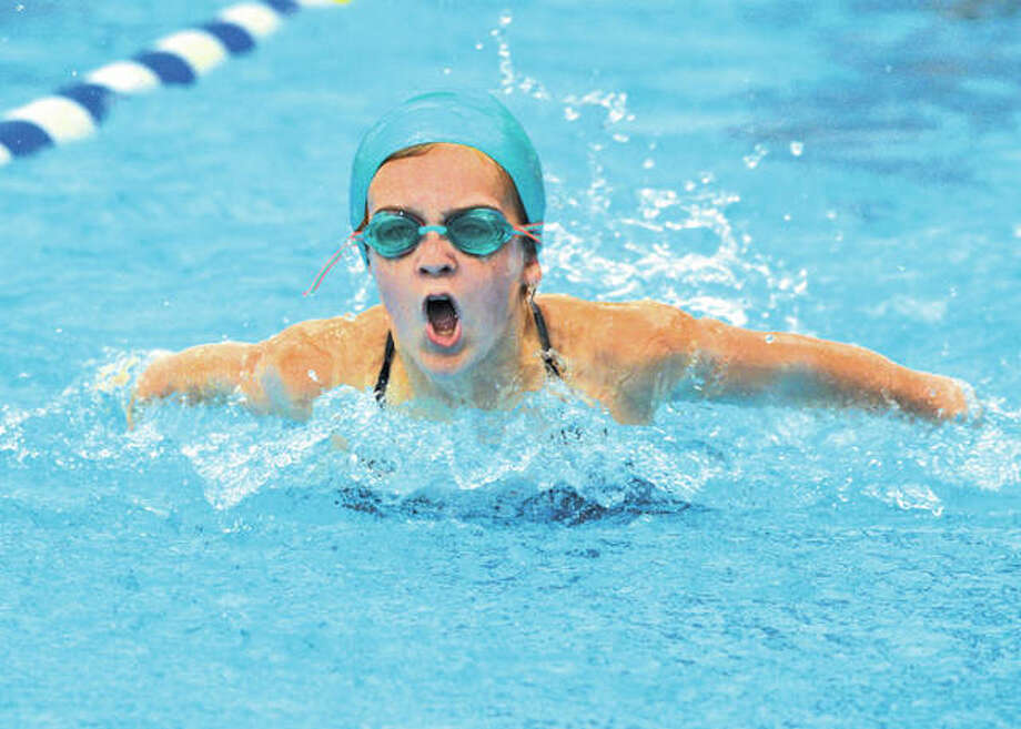 Summers-Port's Grace Schwegel competes in the girls 9-10 100-yard IM on Sunday at the SWISA Championships in Godfrey. Photo:     Scott Marion / Hearst Newspapers