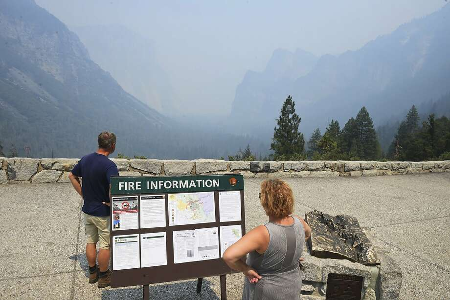 Smoke from the Ferguson Fire fills Yosemite Valley as seen from Tunnel View Tuesday, July 24, 2018, in Yosemite National Park, Calif. A Yosemite National Park official says at least a thousand campground and hotel reservations will be canceled after authorities decided to close Yosemite Valley to keep a growing forest fire at bay. Spokesman Scott Gediman says the valley, the heart of the visitor experience at the park, along with a windy, mountainous, 20-mile (32-kilometer) stretch of State Route 41 that is part of Yosemite will close beginning Wednesday at noon. Photo: Eric Paul Zamora / Fresno Bee