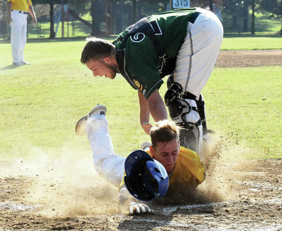 Edwardsville Post 199's Mikey Hampton (bottom) is tagged out at home plate for the second out of the first inning in a Bears win over Aviston on Tuesday at the legion state tournament in Aviston. Photo:       Matthew Kamp / Hearst Newspapers