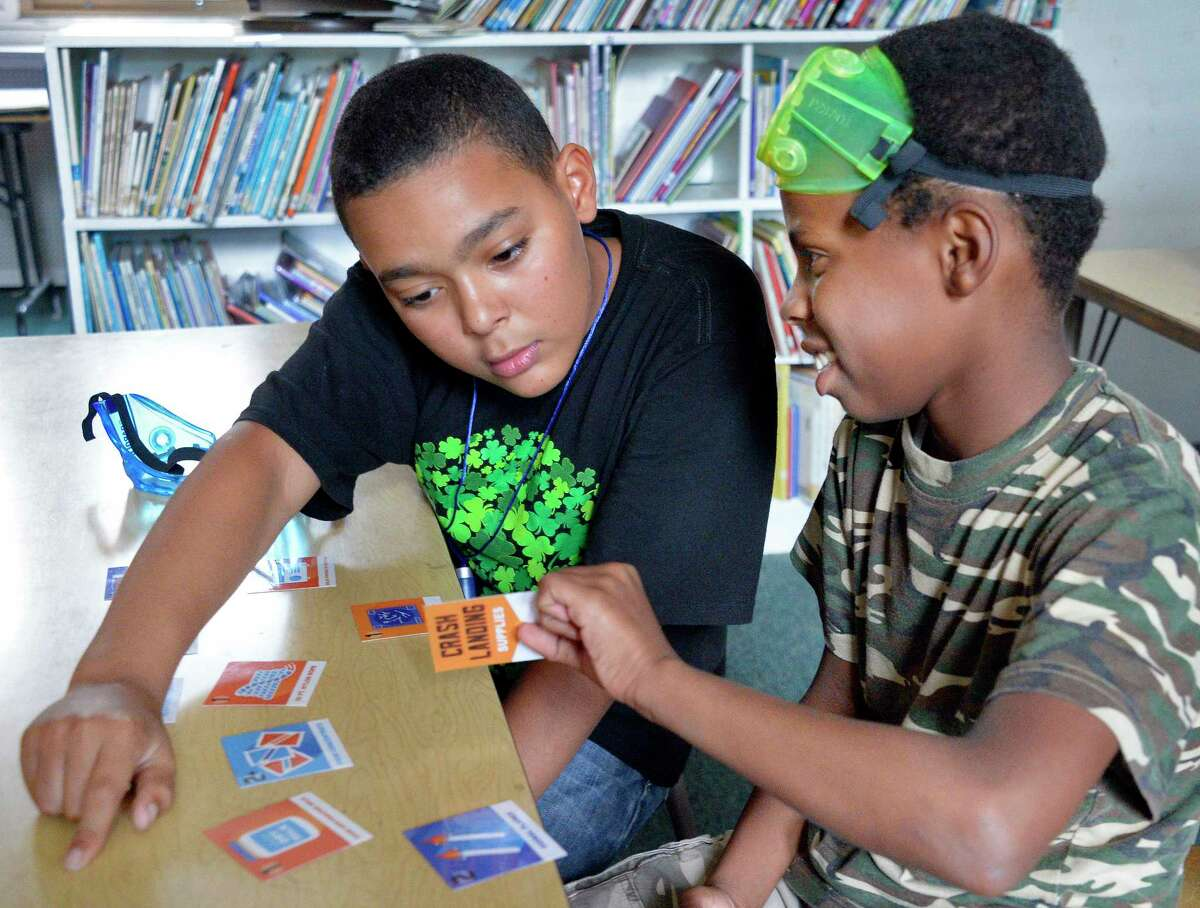 Malachi Witherspoon, left, and Assad Allah study space travel during the GSK Science in the Summer program at Pleasant Valley Elementary School Tuesday July 24, 2018 in Schenectady, NY. (John Carl D'Annibale/Times Union)