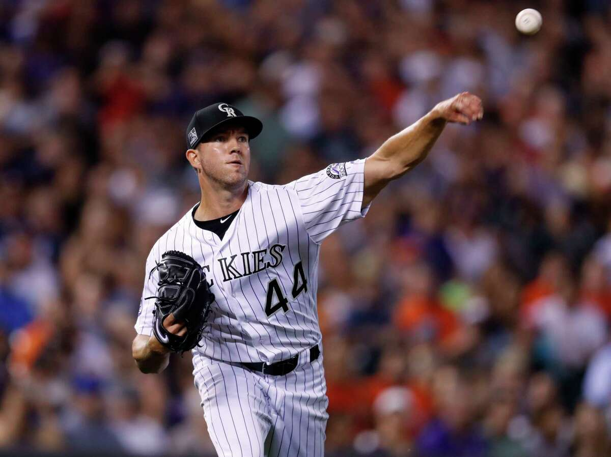 Colorado Rockies starting pitcher Tyler Anderson throws to first base to put out Houston Astros' Max Stassi on a grounder during the fourth inning of a baseball game Tuesday, July 24, 2018, in Denver. (AP Photo/David Zalubowski)