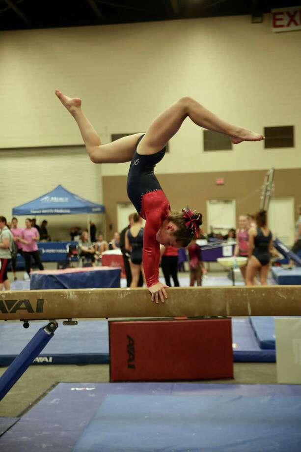 Darien YMCA Level 8 gymnast Sarah Cross scored 9.325 for her beam routine and qualified for the All-Around finals where she placed ninth at the 2018 YMCA National Championships in Toledo. Photo: Contributed Photo / Darien News contributed