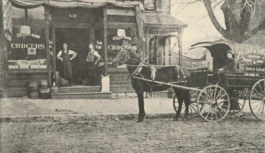 The Zeller & Dunn Grocery was located at 419 Ridge Street for many years. The delivery wagon was ornate, trimmed, and lettered. A canopy protected the driver. The sidewalk appears to be paved, but that sign of civilization had not yet extended to the street. The building housed the Maul & Jones confectioneries, and is now a private residence. Zeller later opened a store on the northwest corner of Fifth & Ridge. The shop was known as Dietschy's for many years, and was remodeled for Buck's Decorating. Jim Dunn opened another grocery also. The building was later occupied by Mook's Art and Craft. Photo:       File Photo