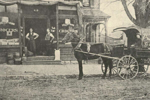 The Zeller & Dunn Grocery was located at 419 Ridge Street for many years. The delivery wagon was ornate, trimmed, and lettered. A canopy protected the driver. The sidewalk appears to be paved, but that sign of civilization had not yet extended to the street. The building housed the Maul & Jones confectioneries, and is now a private residence. Zeller later opened a store on the northwest corner of Fifth & Ridge. The shop was known as Dietschy's for many years, and was remodeled for Buck's Decorating. Jim Dunn opened another grocery also. The building was later occupied by Mook's Art and Craft.