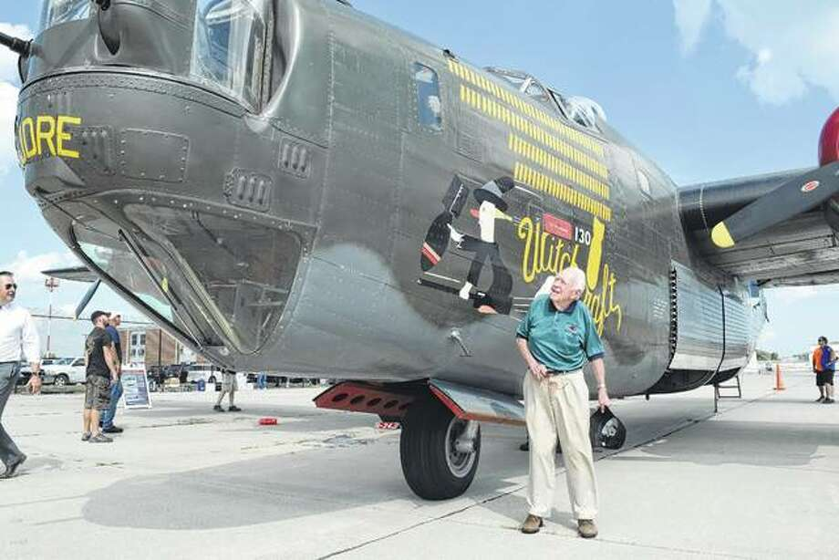 John Neece, 95, of White Hall looks at a B-24 Liberator bomber that is similar to one he flew in during World War II. Neece got to ride in the plane Tuesday at Abraham Lincoln Capital Airport in Springfield. Photo:       Greg Olson | Journal-Courier