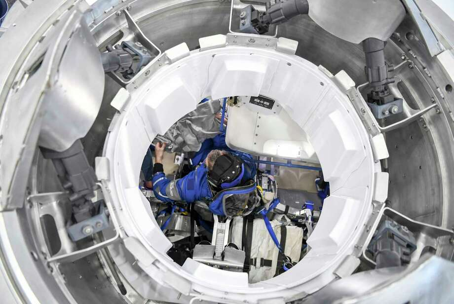 A Boeing Starliner mock-up at NASAs Johnson Space Center in Houston. Keep clicking to learn about the astronauts picked for the Starliner's and the SpaceX Dragon's first flight. Photo: Washington Post Photo By Jonathan Newton. / The Washington Post