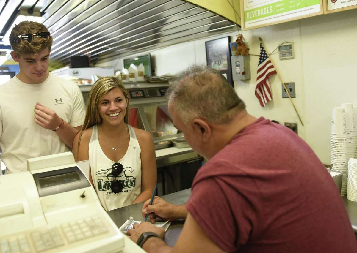 Luke Hawkins, of Evergreen, Colo., and Samantha Circelli, of Greenwich, place an order at Garden Catering in Old Greenwich, Conn. Tuesday, July 24, 2018. The beloved chicken nugget joint is adding a store in New Haven in August, joining seven other locations throughout Fairfield County and Westchester County, N.Y.