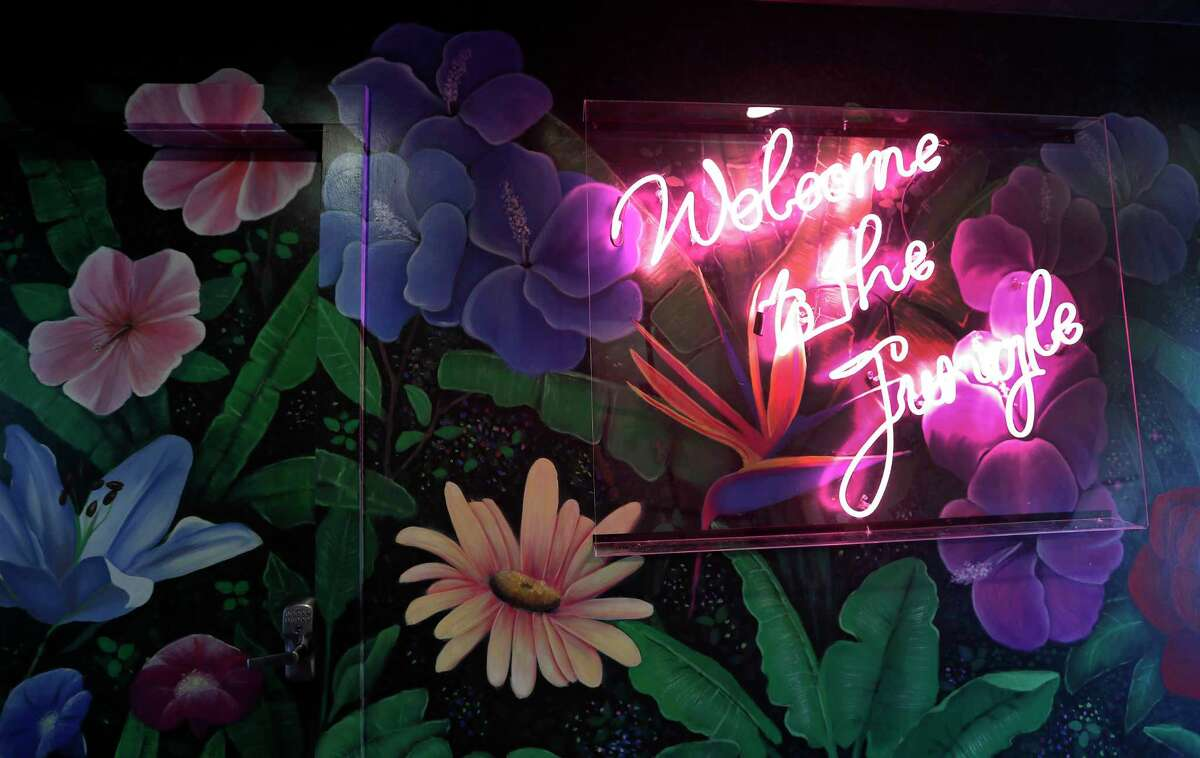 Neon sign inside of the new Montrose bar, Present Company created by restaurateur Shawn Bermudez at 1318 Westheimer.