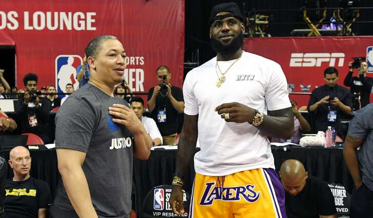 LAS VEGAS, NV - JULY 15:  Head coach Tyronn Lue (L) of the Cleveland Cavaliers talks with LeBron James of the Los Angeles Lakers after a quarterfinal game of the 2018 NBA Summer League between the Lakers and the Detroit Pistons at the Thomas & Mack Center on July 15, 2018 in Las Vegas, Nevada. (Photo by Ethan Miller/Getty Images)