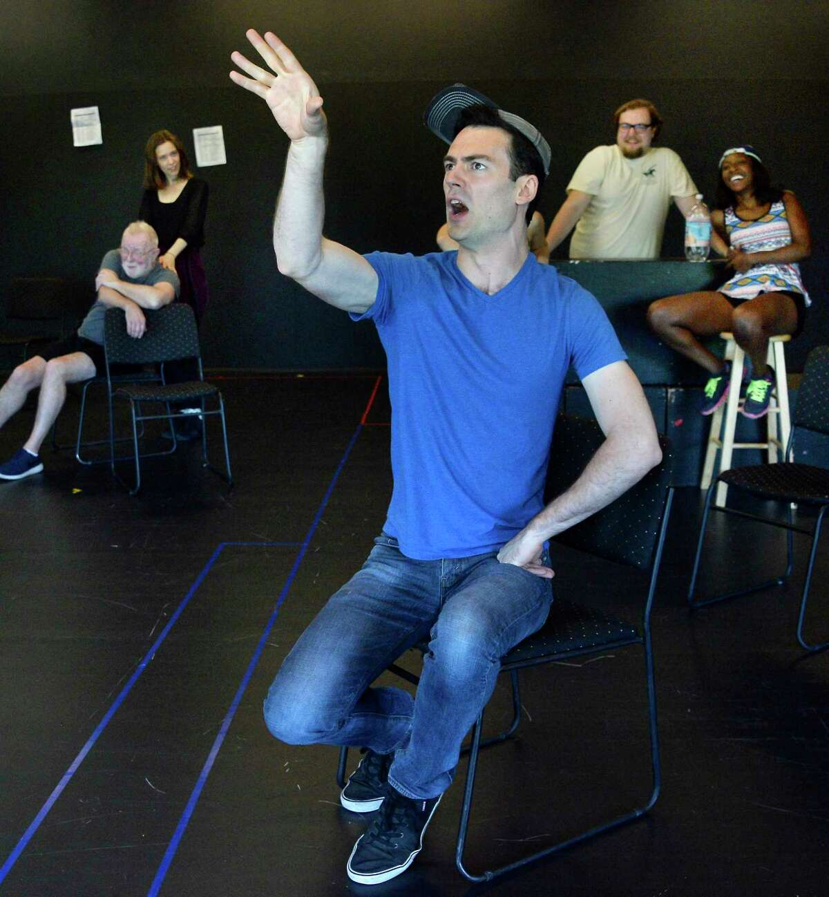 Actor Woodrow Proctor, center, during rehearsals of Saratoga Shakespeare Company's