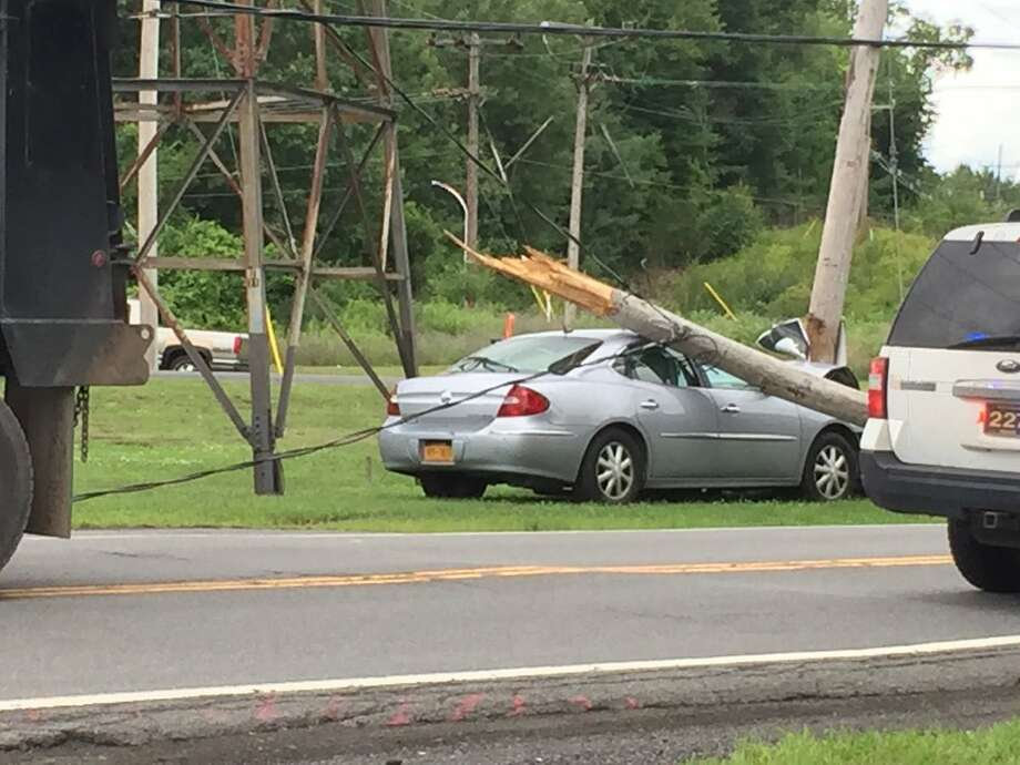 A car crashed into a utility pole Wednesday, July 25, 2018, closing the road from the 890 overpass to Hamburg Street in Rotterdam, N.Y. Photo: Mike Goodwin/Times Union